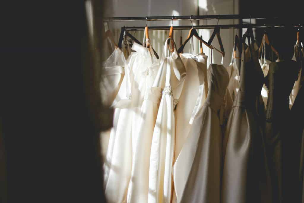 Questions to Ask at Dress Shops; H3: When will my dress be ready, Can I get a fabric swatch of my dress, Do you offer bridesmaid dresses, mother of the bride's dresses and suits?, Can you include all of the details, Do you do alterations?