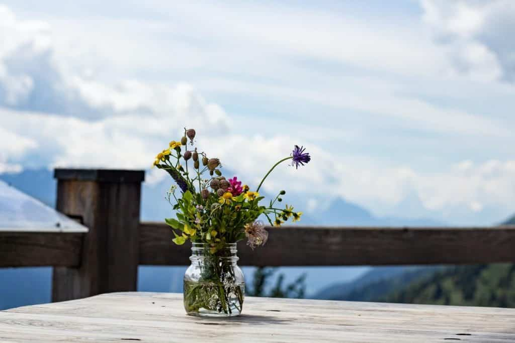 flower vase on a table outside